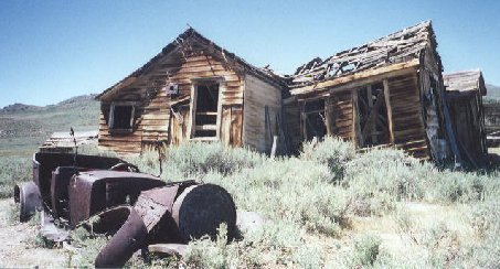 Ruins of a car and home at Bodie Ghost Town